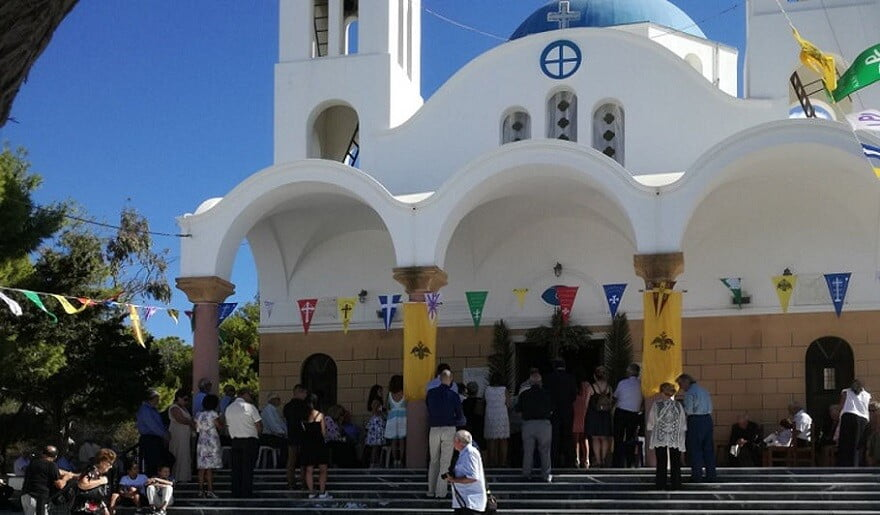 Festival for the Raising of the Holy Cross church with people in front, at Paros, Ageria, Greece