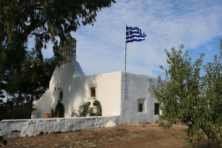 front of the church Pera Panagia commemorate festival of them at Paros, Marmara, Greece surrounded by trees