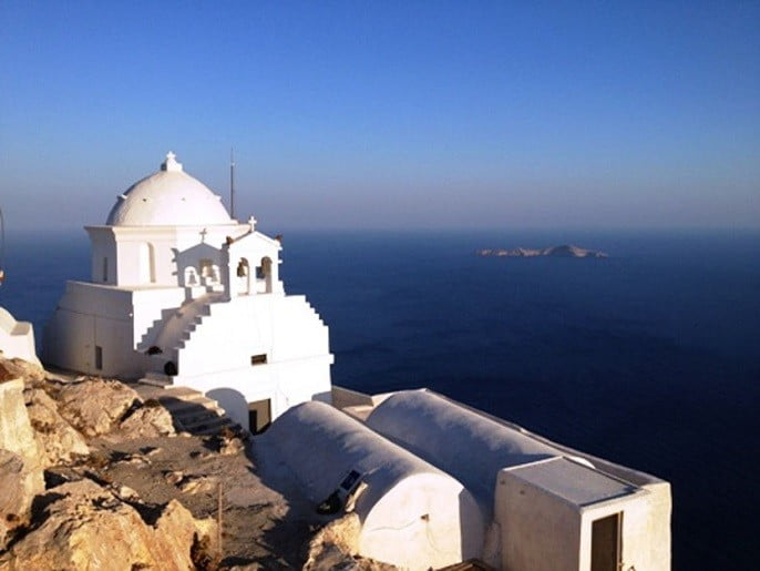 view on the top of the Monastery of the Holy Virgin of Kalamiotissa with cupol and commemorate festival of her birth at Anafi, Greece
