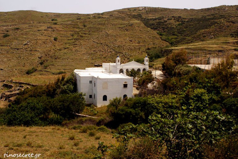 the monastery of the Virgin of Vourniotissa commemorate their St. at festival at Tinos, Greece surrounded by hills, trees