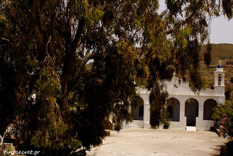 front of the monastery of the Virgin of Vourniotissa commemorate their St. at festival at Tinos, Greece surrounded by trees