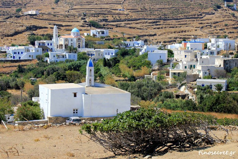 far view of Holy Cross church, Tinos, Ktikados, Greece, surrounded by houses
