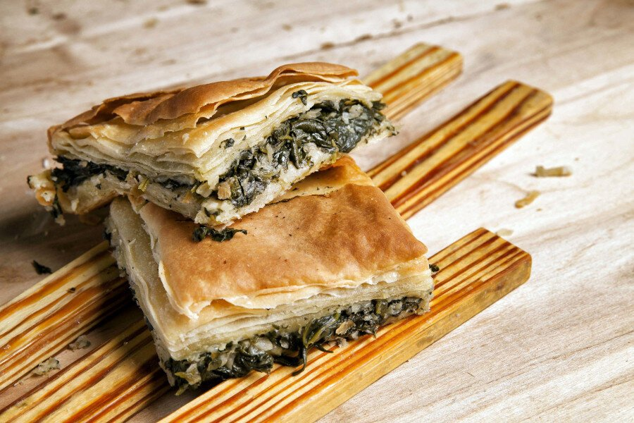 pieces of Greek 'pita' using pastry crust or filo baked in the oven filling with spinach