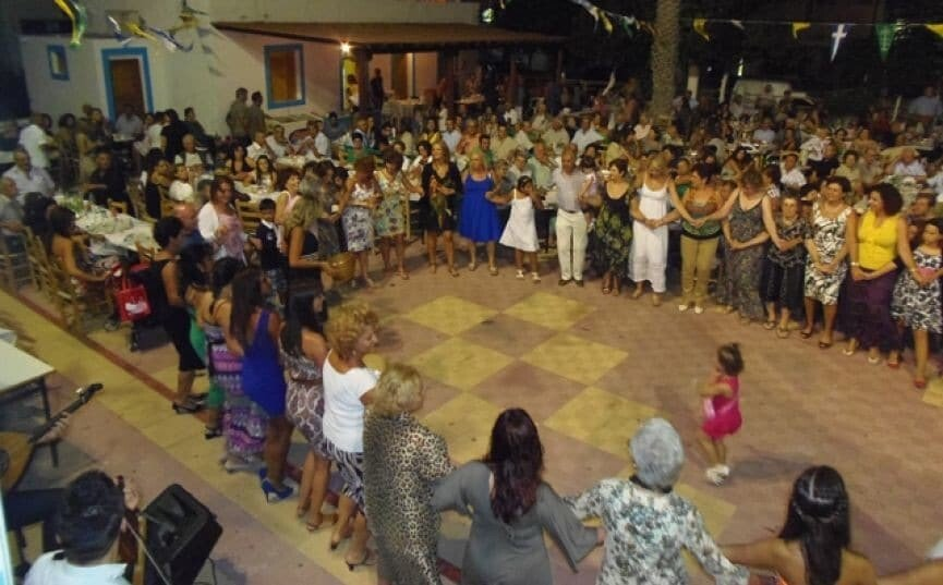 people dancing in circle at the Festival of the Cup at church area, at Kos, Kardamaina, Greece by night