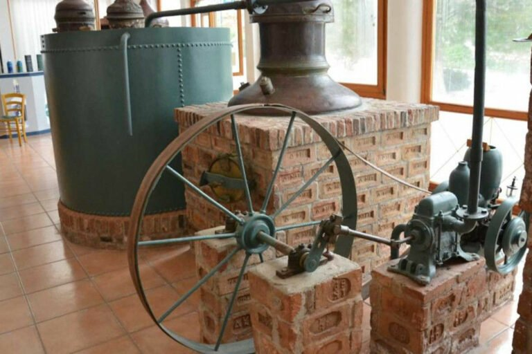 old manual copper distillery with wheel at 'Ouzo Barbayannis' museum